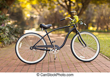 new bicycle at the park with flowers - new black bicycle at...