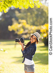 young photography student take photos outdoors - cheerful...