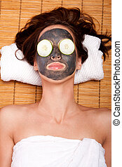 Womale facial mask skincare spa - Woman face with beauty...