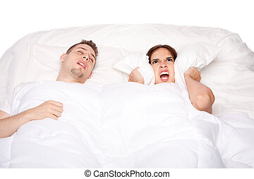 Snoring and asleep - Couple laying asleep in bed while man...