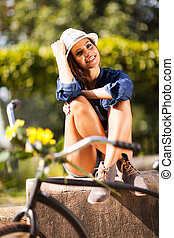 young woman relaxing outdoors - cheerful attractive young...