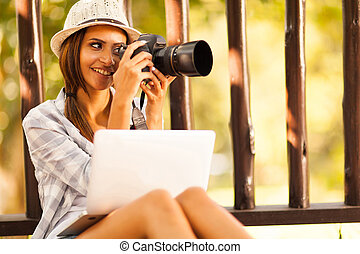 female photographer taking pictures at the park