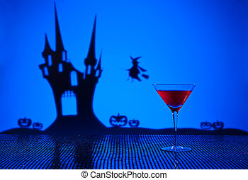 Cosmopolitan cocktail in Halloween setting - Halloween...