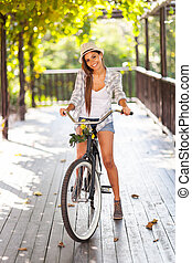 young woman riding bike outdoors