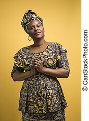 Woman in African dress. - African American female mature...