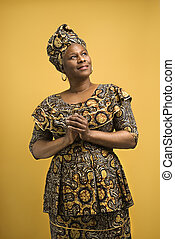 Woman in African attire. - African American female mature...