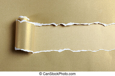ripped gold paper over light gold background