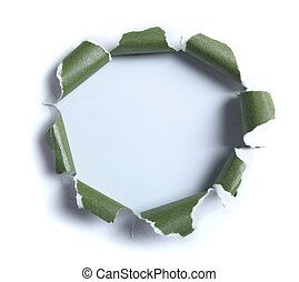 Hole ripped in white paper with green paper