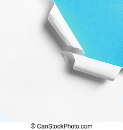 Piece of white paper with torn hole edge over blue...