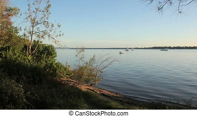 Early Morning Shoreline - Boats on a calm morning seen from...