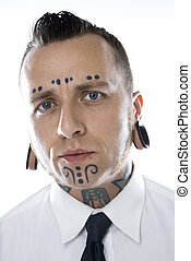 Adult male with tattoos and piercings. - Caucasian mid-adult...