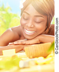 American woman enjoying day spa - Closeup portrait of cute...
