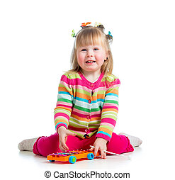 child girl playing  with musical toys