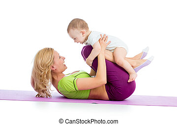 mother with baby doing gymnastics and fitness exercises