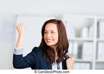 Successful woman - Portrait of successful woman clenches her...