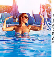 Woman have fun in the pool