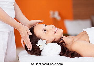 Smiling woman - Smiling fresh woman having head massage in...