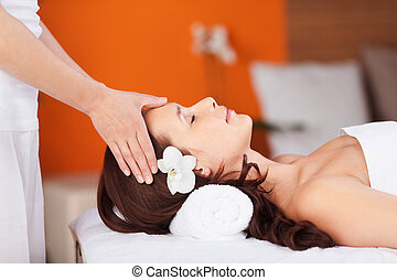 Head massage - Relaxing fresh woman having head massage in...