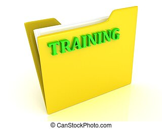 TRAINING bright green letters on a yellow folder with papers...