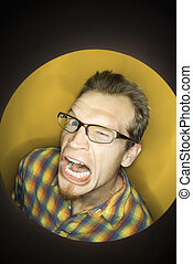 Man making funny face - Vignette of adult Caucasian man on...
