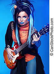 Rock girl posing with electric guitar playing hard-rock...