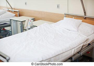 Empty Hospital Bed - Interior of fresh white empty hospital...