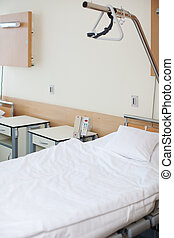 Empty Bed In Hospital - Interior of empty white bed in...