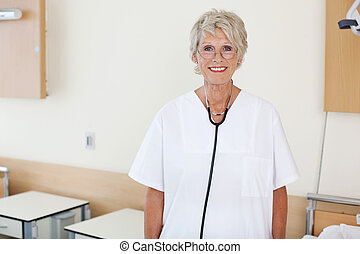 Female Nurse An Hospital - Smiling senior female nurse...