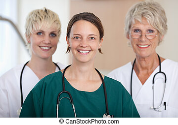Confident Medical Team Of Doctors Smiling In Clinic -...