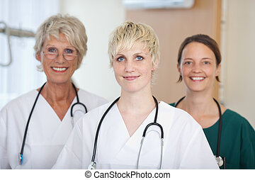 Confident Medical Team Of Female Doctors - Portrait of...