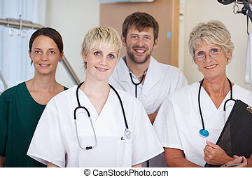 Doctors Team Smiling Together in hospital - Portrait of...