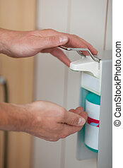 Doctors Hands Using Sanitizer Dispenser - Doctors hands...
