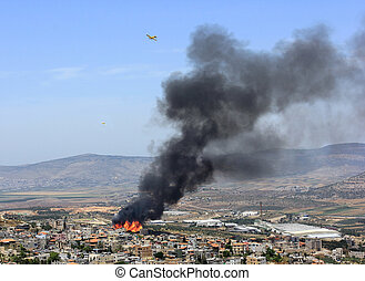 fire in the palestinian village of Mashhad near Nazareth -...