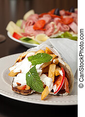 Greek Gyro and Antipasto Salad - Traditional Gyro sandwich...