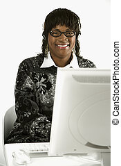 Woman typing on computer.