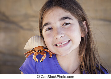 Young Girl Playing with Toy Hermit Crab - Young Pretty Girl...