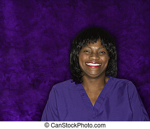 Smiling woman in medical uniform.