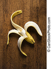 Half eaten banana. - Close up still life of half eaten...