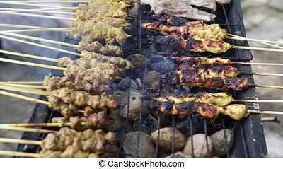 Grilling Chicken Satay - Chicken satay on the grill