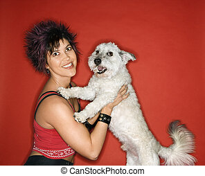 Young woman and white dog.