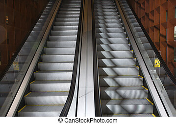 Escalators. - Ascending and descending escalators.