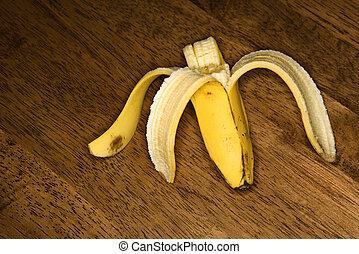 Half eaten banana. - Still life of half eaten banana on...