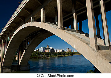 Saskatoon View from under Bridge - Downtown Saskatoon as...