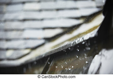 Heavy rain - Old tiled roof in heavy rain - selective focus