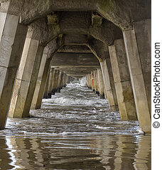 Concrete foundation pilings of Tolaga Bay Wharf NZ - Ocean...