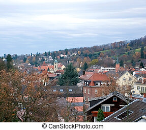 small town and Autumn - small quiet town stands in hills....