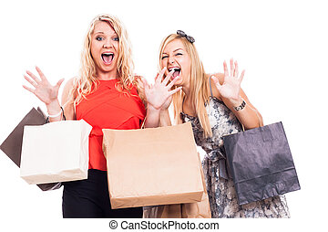 Crazy girls shopping - Two crazy blond girls shopping,...