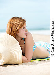 Smiling Woman In Bikini At Beach - Beautiful smiling redhead...