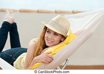 Happy Woman Daydreaming In Hammock - Happy young redhead...
