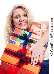 Desperate woman with many gifts - Desperate woman holding...